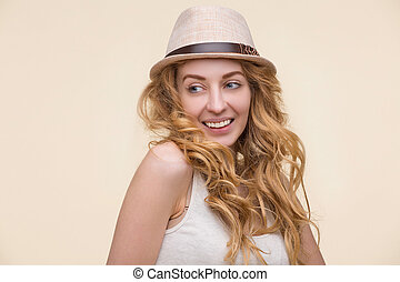 Pretty lady - Long-haired carroty with cream hat on posing...