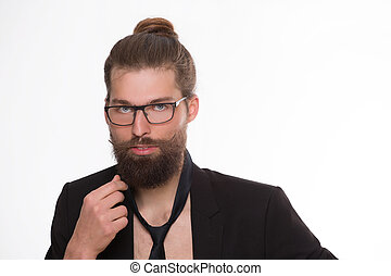 Bearded model makinf fashion with his glance trhough...