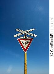 Railway Crossing Sign - Railway crossing sign on a bright...