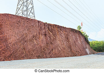 Texture of mountain showing red soil after excavated to...