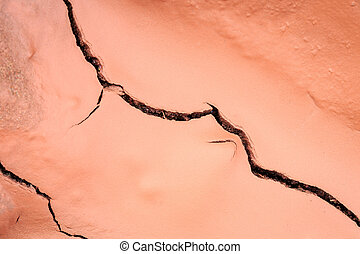 Cracked red soil after effect from rain - Macro of cracked...