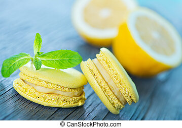 macaroons - lemon macaroons and mint leaf on a table