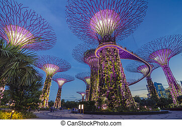 SINGAPORE -MAY12: Futuristic view of amazing illumination at Garden by the Bay on May 12, 2014 in Singapore. Night light show at Supertree Groveis is main Marina Bay Sands district tourist attraction