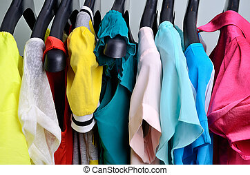 multicolored womens clothing hanging on the hanger...