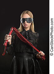 girl with red leather whip and mask BDSM - portrait of a...