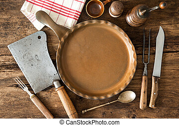 Vintage kitchen utensils on wooden table