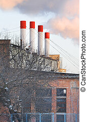 Power station with the smoke of red chimneys