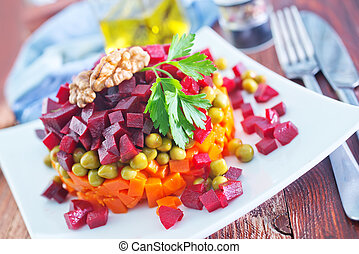 vegetable salad on plate and on a table