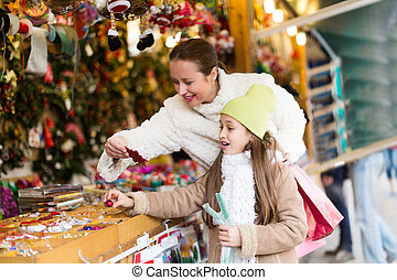 shopping at the Christmas market - woman with smiling...