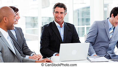 Portrait of an international business team clapping in a...
