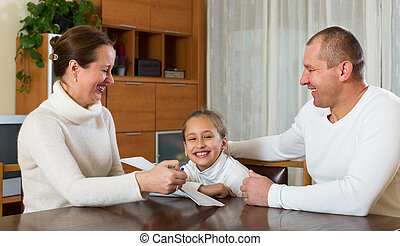 Family with documents - Happy parents and child with...