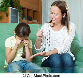 Woman scolds the child -