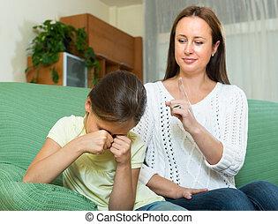 Woman berating crying daughter