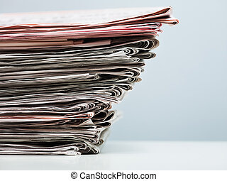 old newspapers in stack. Copy space