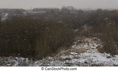 Heavy snowing in the city. Omsk in Russia.