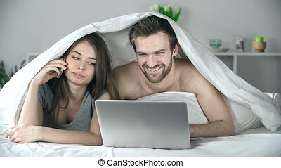 Spending Time Together - Close up of couple lying in bed,...