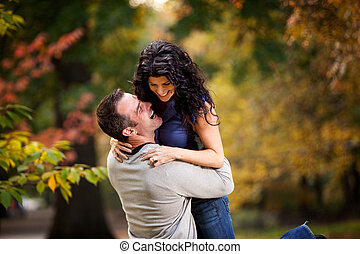 Excited Man and Woman - An excited couple giving eachother a...