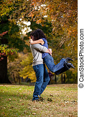 Big Hug - A man giving a woman a big hug - lifting her off...