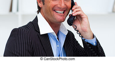 Close-up of a smiling businessman talking on phone