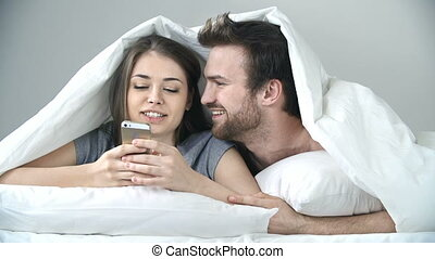 Bursting with Tenderness - Front view of couple resting in...