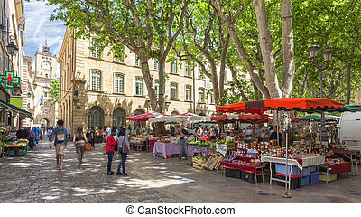 Market on a square in Aix en Provence, France