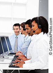 Smiling young business people in a call center
