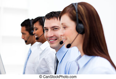 Customer service agents in a call center with headset on