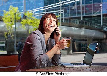 Happy business woman talking on mobile - Portrait of a happy...