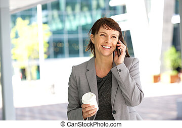 Happy businesswoman on the go - Close up portrait of a happy...