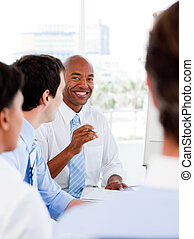 Portrait of smiling business team during a meeting in the...