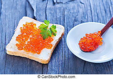 bread with caviar on the wooden table