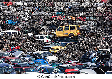 Car recycling facility - Stacked wrecked cars going to be...
