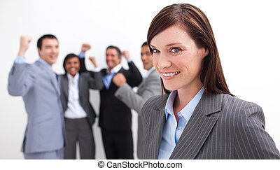 Happy Manager celebrating a success with her team in the...