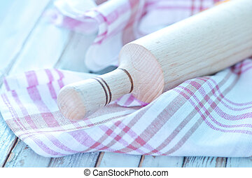 rolling pin and napkin on a table