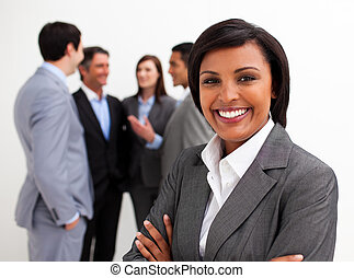 Beautiful businesswoman leading her team agaisnt white...