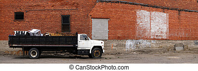 Panorama of Work Truck and Brick Wall