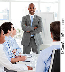 Afro-american businessman giving a presentation to his team