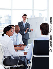 Portrait of business people discussing a new strategy at a...