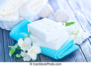 spa - white soap and towels on a table