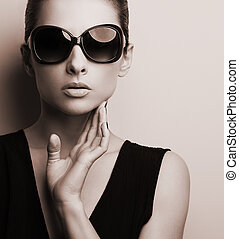 Stylish fashion female model in fashion sunglasses posing...