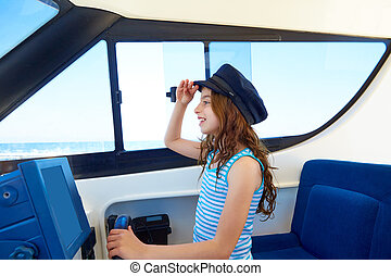 Kid girl pretending be a captain sailor cap in boat