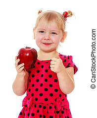 Adorable little blonde with a red Apple in his hand , close-up