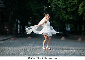 Bride jumps with vail - Bride jumping on the background of...