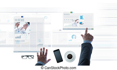 Businessman pointing at financial reports and news slides -...