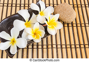 Tropical Plumeria and stone therapy on Bamboo Mat - Tropical...