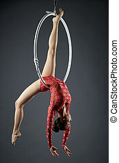 Studio photo of cute dancer posing on aerial hoop - Studio...