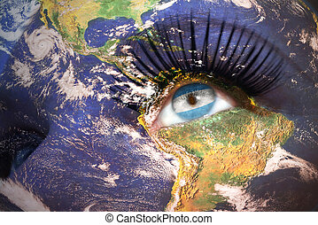 woman and 39;s face with planet Earth texture and...