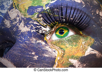 woman and 39;s face with planet Earth texture and brazilian...