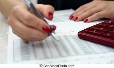 woman audit financial reports - businesswoman audit...
