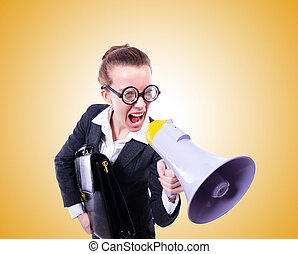 Young businessman with loudspeaker against the gradient